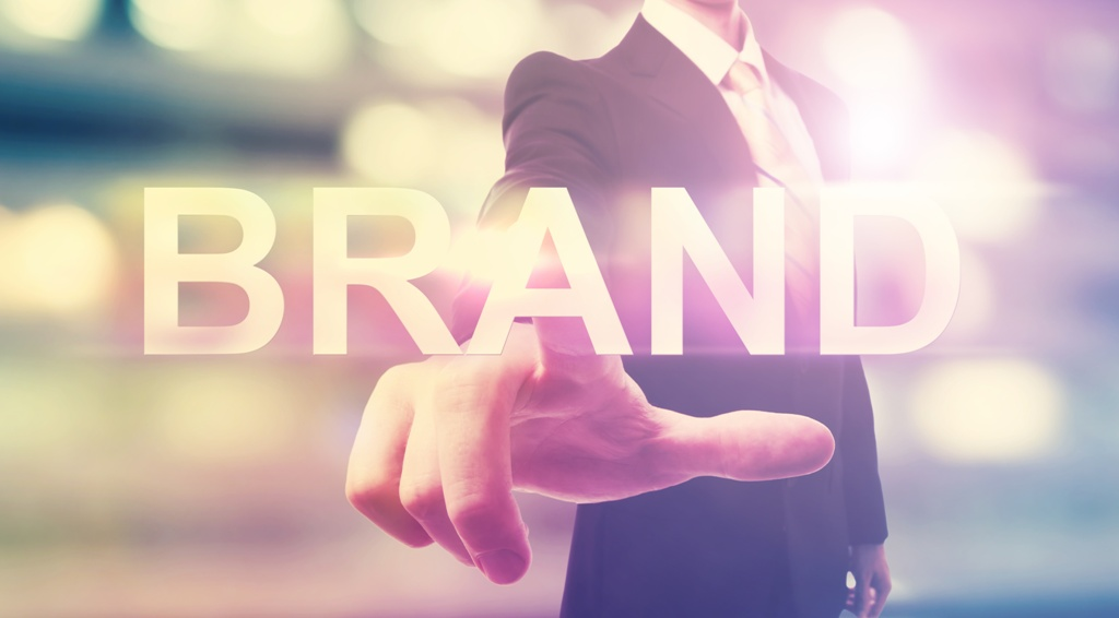 Businessman pointing at BRAND